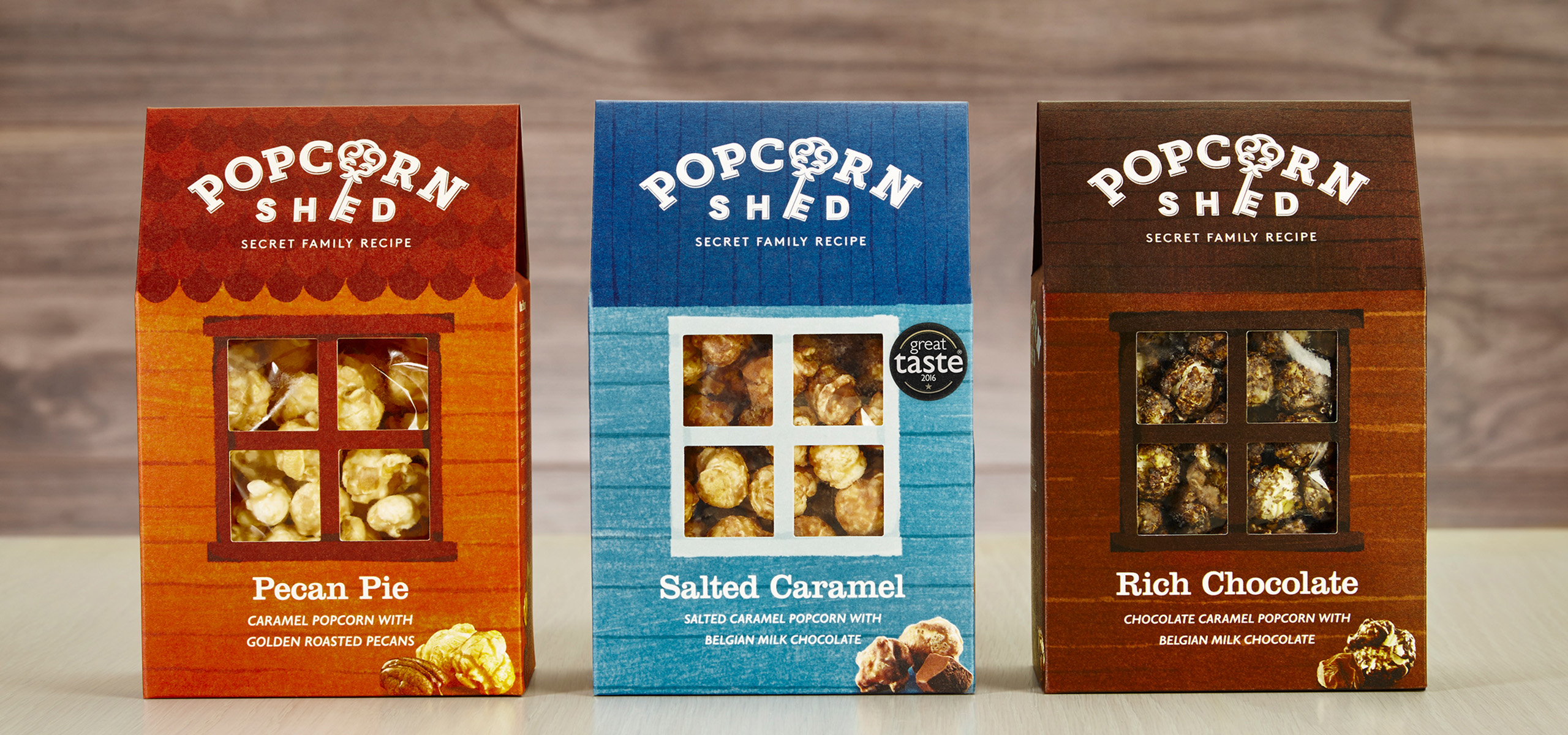 3 popcorn boxes packaging design for food startup brand Popcorn Shed, designed by White Bear Studio