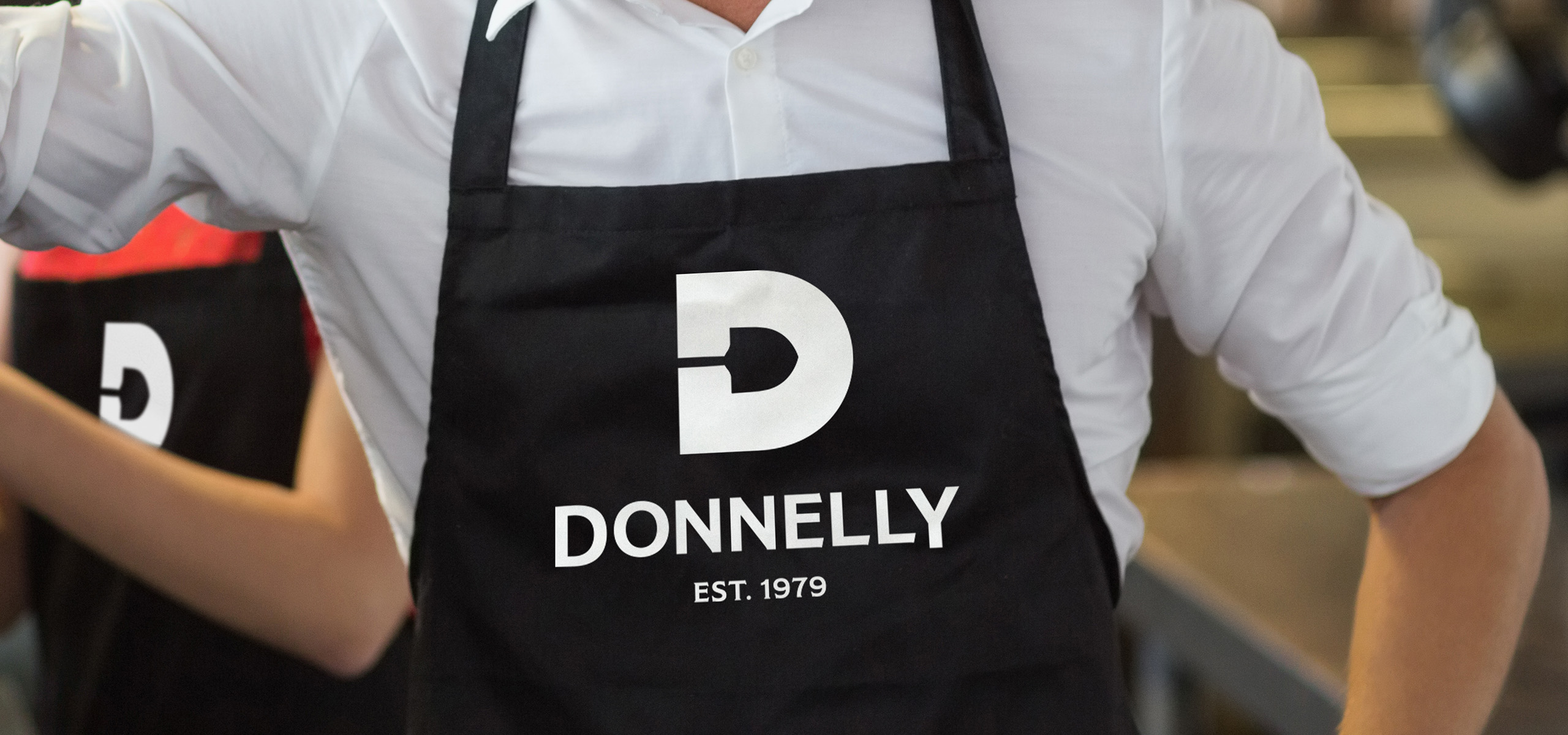 Apron mockup for food brand Donnelly, designed by White Bear Studio