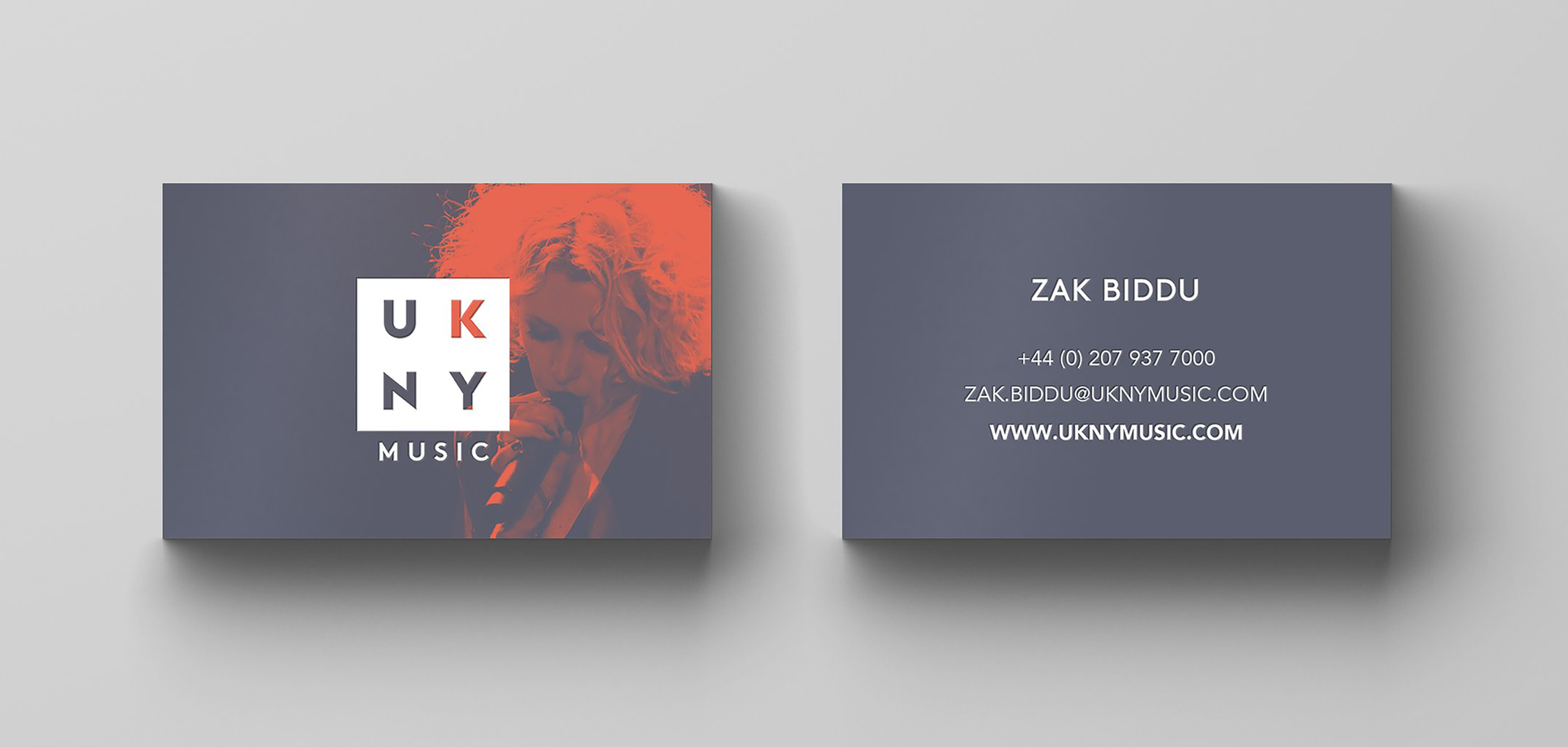 Business card mockup for entertainment brand UKNY, designed by White Bear Studio