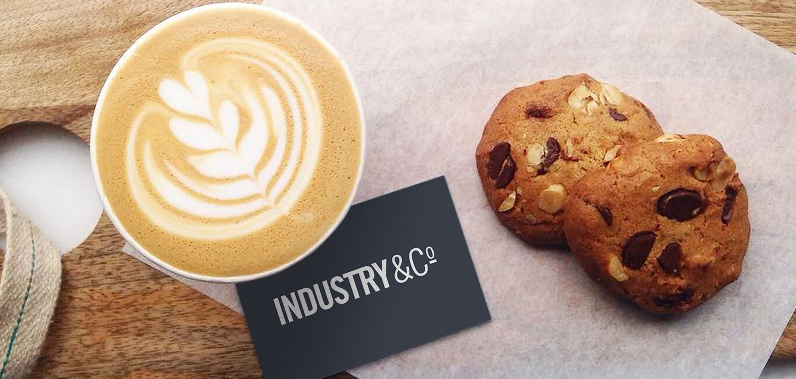 Coffee and business card for Irish lifestyle shop Industry & Co, designed by White Bear Studio